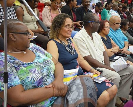 Carol Lady Haynes (second from left) was among those attending the presentation by Sir George Alleyne.