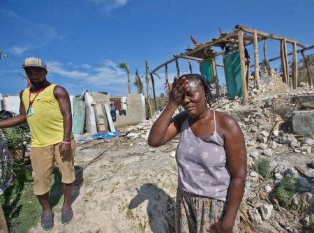 Cholera Marie Louse Valentin, 54, weeps in front of her shattered home in Morne la Source, Haiti. Photo Credit -  Patrick Farrell – Miami Herald.
