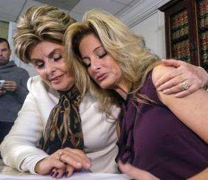 Attorney Gloria Allred (left) comforts Summer Zervos during a news conference in Los Angeles, Friday.