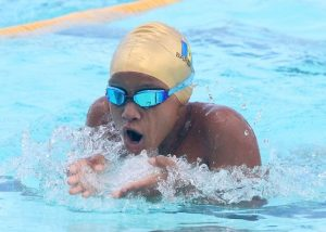 Christopher Pollard of Red House doing the breaststroke during the boys 12 and under 100m individual medley.