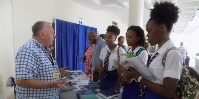 Co-director of the UK Education Services in the Caribbean (UKESC),  Jeff Atherton telling students of Queen's College about British universities.