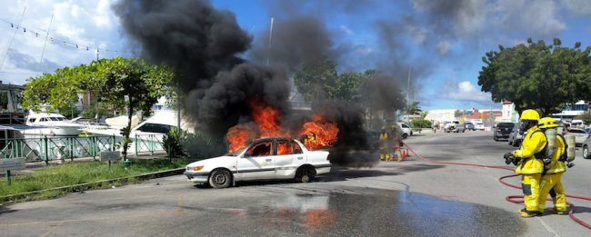 This car caught afire during the simulated accident.