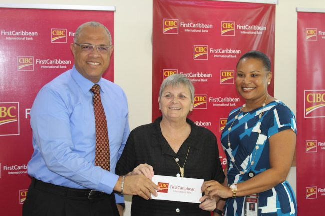 From left, Managing Director of Retail Banking at CIBC FirstCaribbean Mark St Hill, United Caribbean Trust founder Jenny Tryhane, and Managing Director of Barbados Business Donna Wellington.