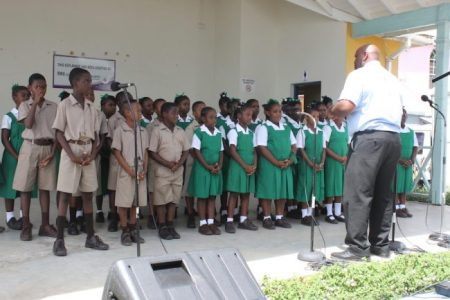 Choir from Ignatius Byer Primary led with a tribute to the late Errol Barrow.