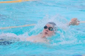 Jacob Coles of Red House competing in the boys 15 and over 50m backstroke.