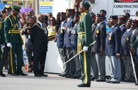 Governor General Sir Elliott Belgrave inspects a squad of veterans.