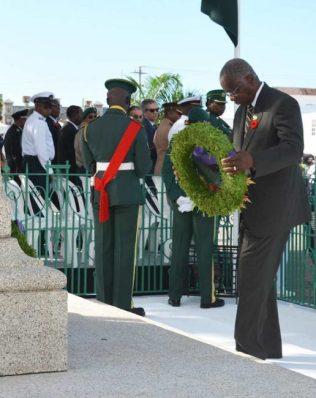 Prime Minister Freundel Stuart lays a wreath at the cenotaph.