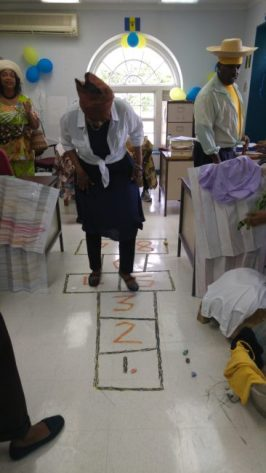 Education Officer in the Nursery and Primary section Janice Reid playing hopscotch in the village.