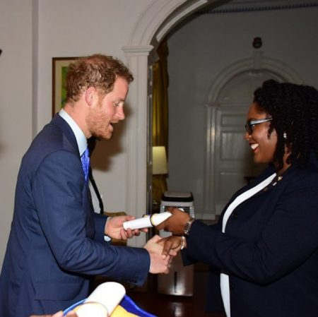 Duke of Edinburgh Gold Award winner Jade Gibbons was all smiles as she received her certificate from Prince Harry.