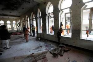Afghan Municipality workers sweep Baqir-ul Ulom mosque after a suicide attack, in Kabul, Afghanistan. An Afghan official says that dozens of civilians have been killed after a suicide bomber attacked a Shiite mosque in the capital.