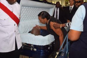 A loved one saying her final goodbye to the late Sergeant Elvis Grafton Foster.