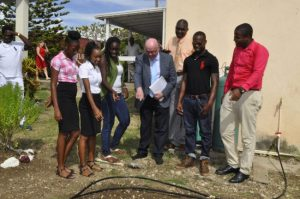 Interim British High Commissioner Robert Gibson (third from right) being shown features of the restored kitchen garden at the Thelma Vaughan Memorial Home by participants of the Prince's Trust International pilot project.