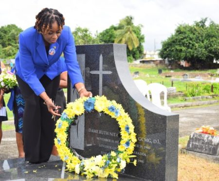 Senator Irene Sandiford-Garner laying a wreath at the late Dame Nita Barrow's grave this morning.