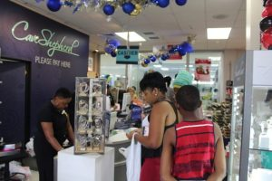Some of the customers checking out at the Cave Shepherd Sheraton Mall location.