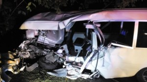 The wrecked staff bus that was involved in the deadly crash on Tuesday night.