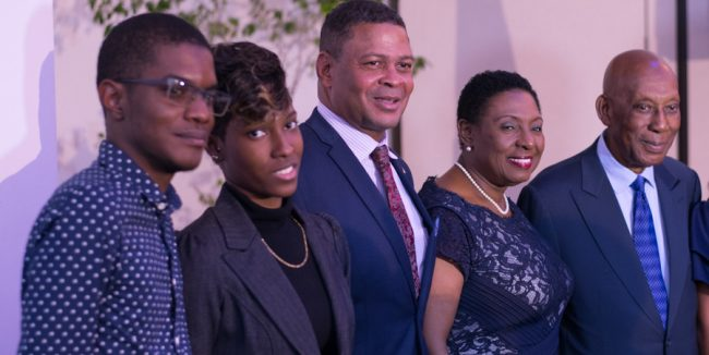 Jamaica's Minister of Culture, Gender, Entertainment & Sports Olivia Grange (second from right) and Honorary Consul of Barbados Winston Bayley (first from right) pose with two Barbadian students.