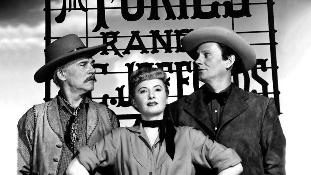 Barbara Stanwyck, Walter Houston and Wendell Corey pose dressed as their western characters for a publicity still of The Furies, one of Barbara Stanwyck's best movies.