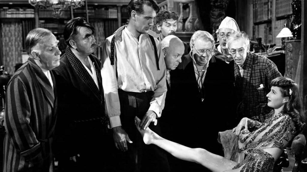 "Barbara Stanwyck shows Gary Cooper and the ""professors"" a glimpse of the real life in this scene of one of Barbara Stanwyck Top movies, screwball comedy Ball of Fire"