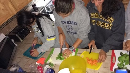 Have Fun. Cook Together! College friends speed up prep time with assembly-line chopping.