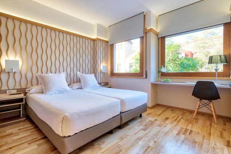 Slaapkamer in BonaNova Suite Barcelona