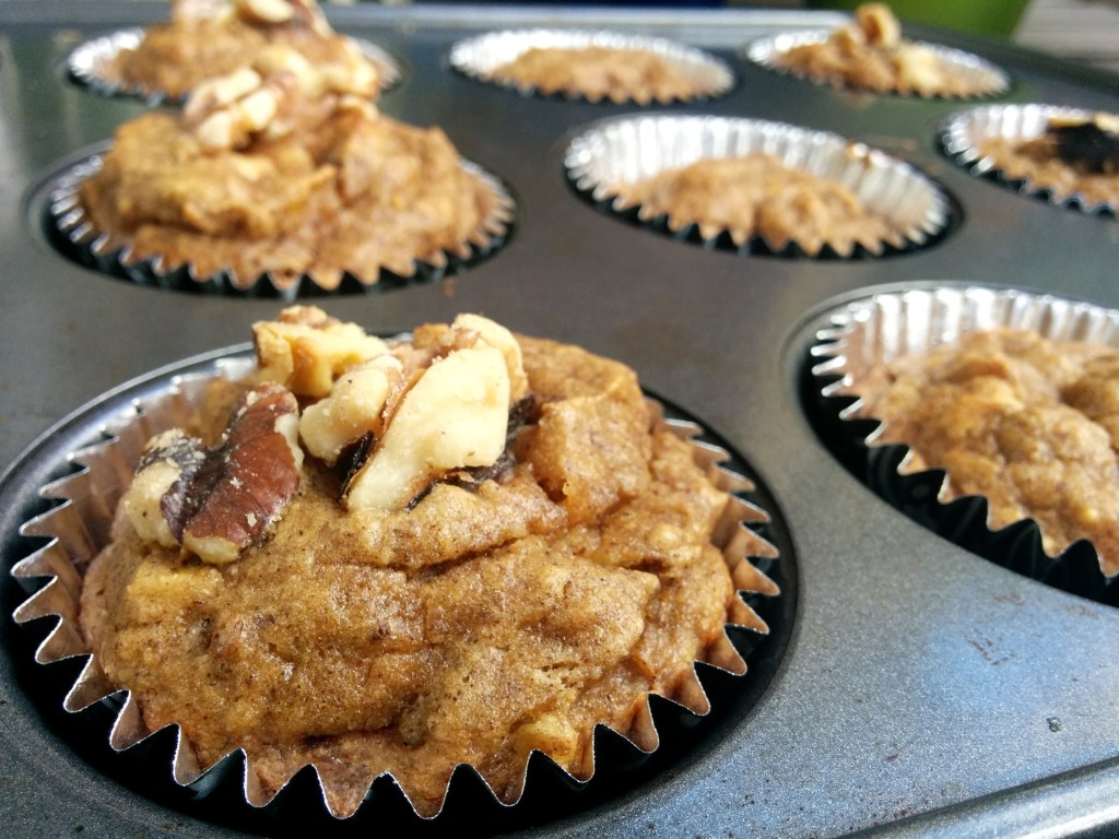 Banana Muffins made with almond butter and topped with walnuts