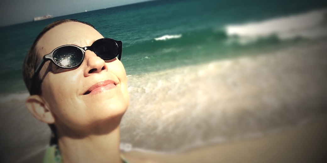 photo of Rox smiling on the beach