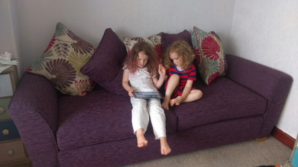 Plum & PK test out the new sofa
