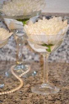 Carnations in vintage cocktail glasses._small