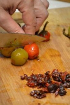 SO chopping the sundried tomatoes and stuffed peppers_small