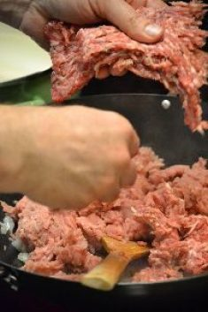 adding the spicy and sweet Italian sausages_small