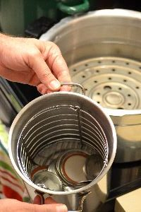 boil the jar lids in a pot on the stove to sterilize_small