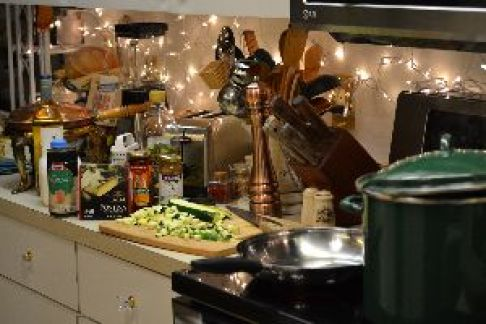 11 a holiday kitchen all lit up with lights and food_small