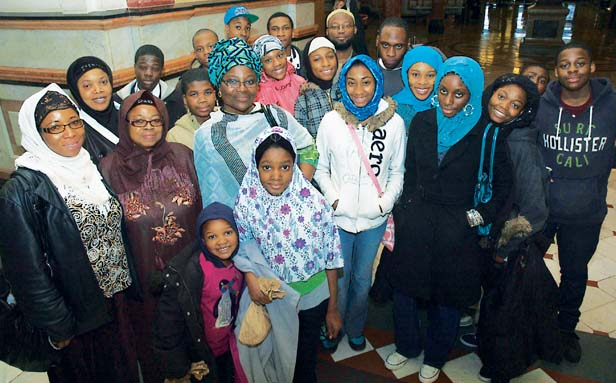 Teenage Muslims got down on their hands and knees for afternoon prayer on the floor of the Statehouse after a rally on Muslim Action Day at the Illinois Capitol Bldg. Nearly 1,200 Muslim faithful converged on the state capital to push for education reform, civil rights and the environment.