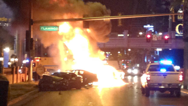 Smoke and flames billow from a burning vehicle following a shooting and multi-car accident on the Las Vegas Strip in Las Vegas