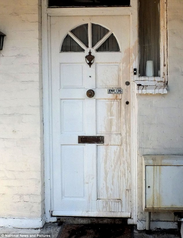 The front door of the  property has been stained by the acid which was thrown in the victim's face