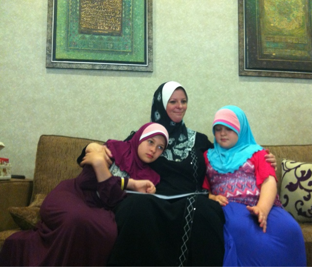 Booth with her two daughters who have been forced to become Muslim slaves like their mother