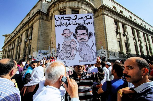 just-outside-of-the-supreme-courthouse-egyptians-protest-the-presidential-appointment-of-a-muslim-brotherhood-member-as-the-countrys-top-prosecutor