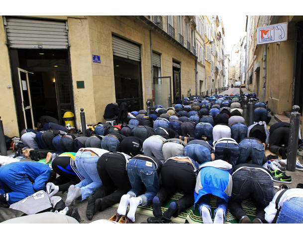 Muslims pray in the street during Friday prayers near the al-Quds mosque in Marseille