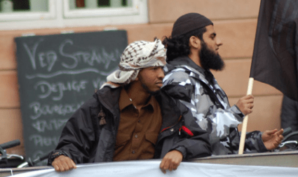 Muslims dressed in jihad-inspired clothes carried the black flag of al-Qaeda