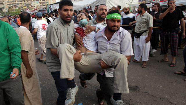 Wounded man being carried in Cairo