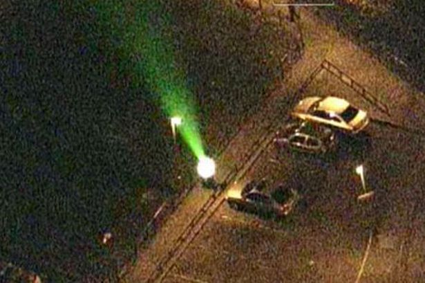 A youth caught shining a laser pen at a police helicopter