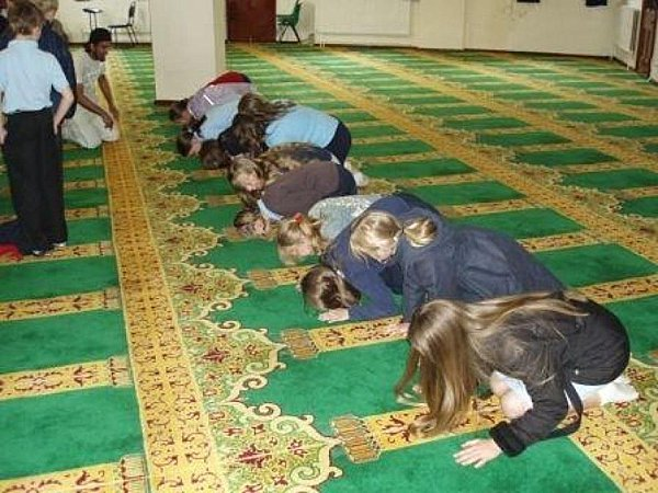 Young schoolgirls taken to a mosque on a field trip are forced to get down on the floor and pray to Allah