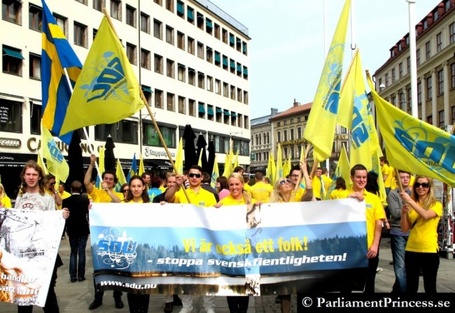 """Sign says, """"We are also a people. Stop hostility towards Swedes."""""""