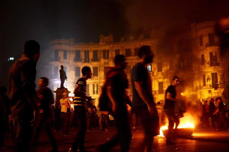 Egyptian protesters set fire to barricades after clashes with security forces Nov. 26th