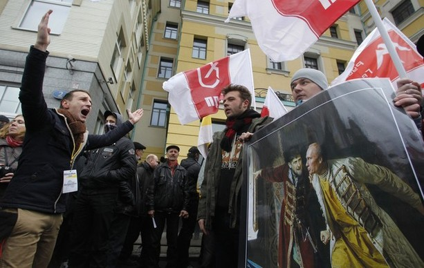 "Participants attend a ""Russian March"" demonstration on National Unity Day in Moscow"