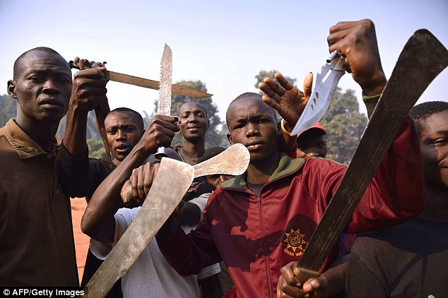 Men brandish machets and knives to threaten Muslim