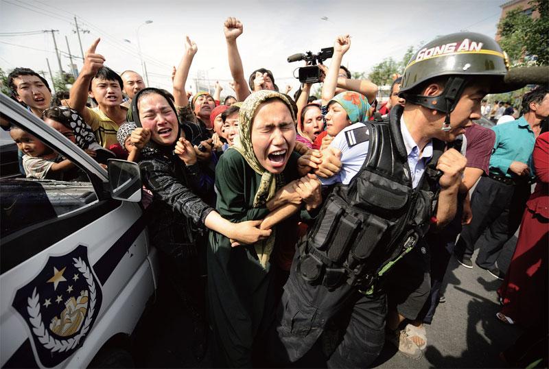 Uighur Muslim women clash with police