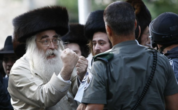 Ultra-Orthodox Jew gestures during a protest in Jerusalem