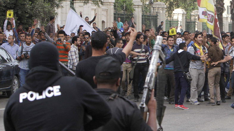 Egyptian police facing pro-Morsi protesters in Cairo in Nov. 2013