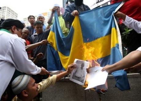Muslims burning the Swedish flag